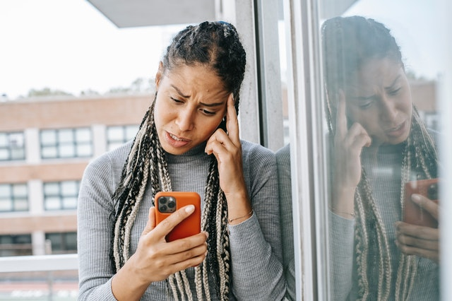 A woman on the phone looking frustrated